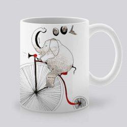 Сутрешната чаша кафе или чай става още по-приятна, с дизайнерската ни керамична чаша с щампа Слон колоездач.