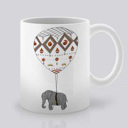 Сутрешната чаша кафе или чай става още по-приятна, с дизайнерската ни керамична чаша с щампа Слон вързан за балон.